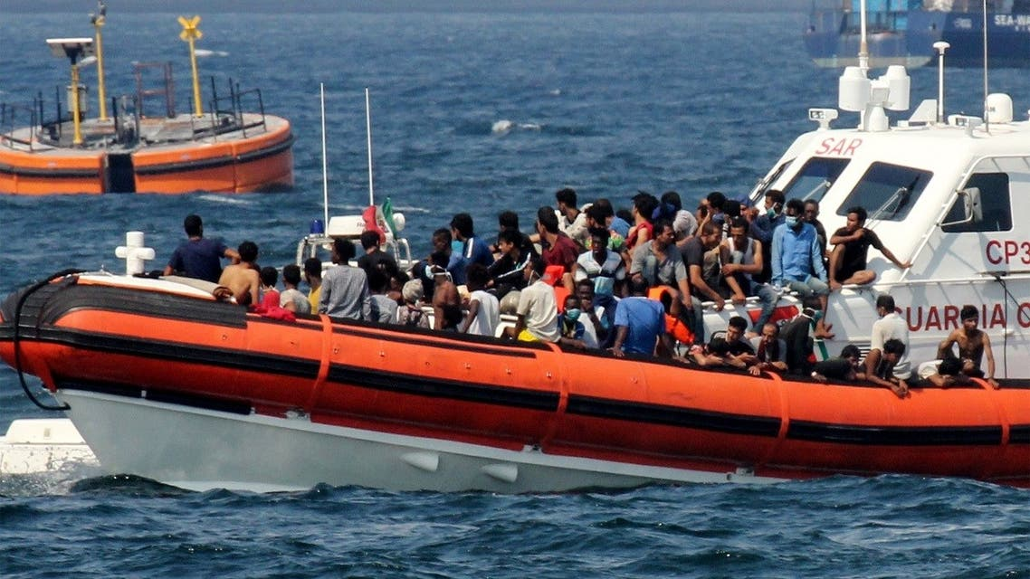 A patrol boat of the Italian Coastguards transports migrants towards the port of Palermo, Sicily, on September 17, 2020 after they rescued them at sea. (Alessandro Fucarini/AFP)