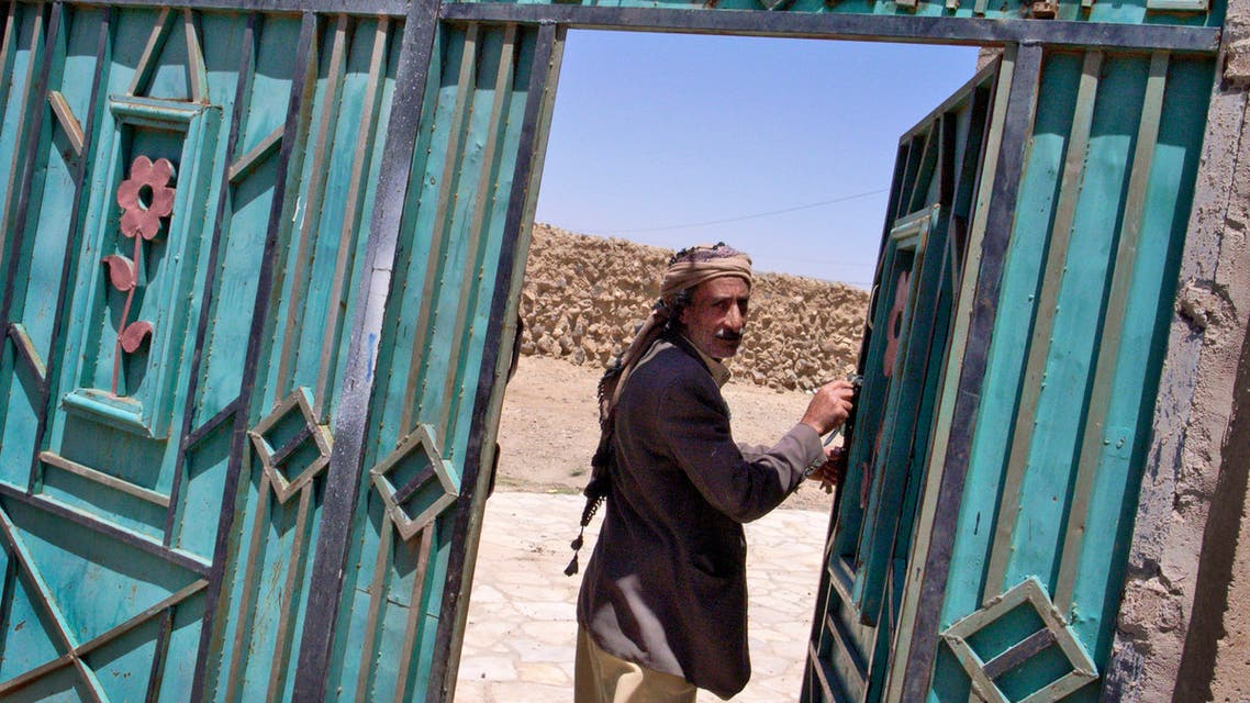 An unidentified Jewish man walks through the metal gate leading to a Jewish girls' school and makeshift synagogue in Kharif, Yemen. (File photo: AP)