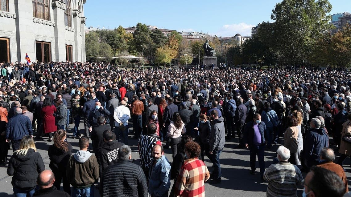 People attend an opposition rally to demand the resignation of Armenian Prime Minister Nikol Pashinyan following the signing of a deal to end the military conflict over the Nagorno-Karabakh region, in Yerevan, Armenia, on November 11, 2020. (Reuters)