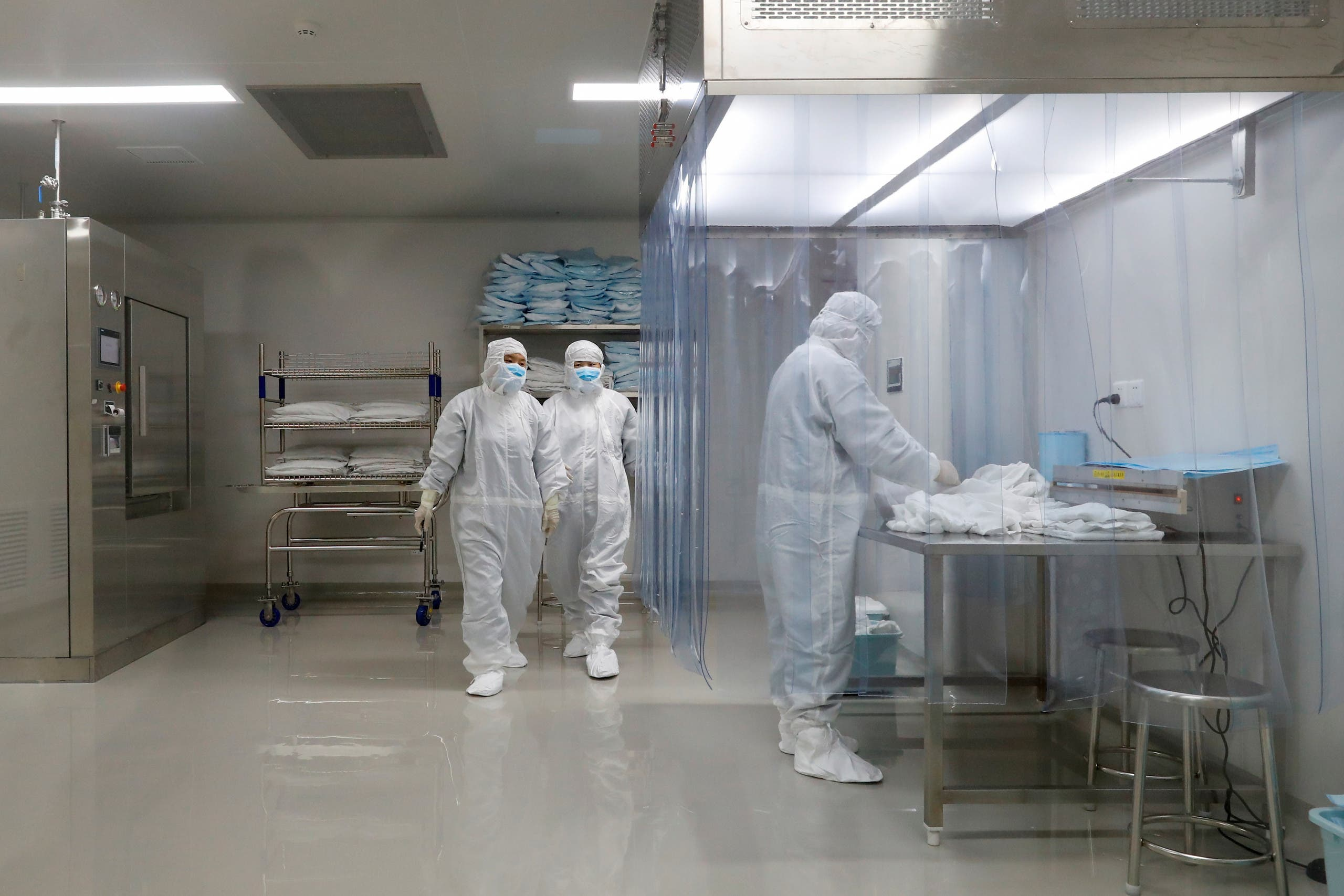 People work at a facility of Chinese vaccine maker Sinovac Biotech, that is developing an experimental coronavirus disease (COVID-19) vaccine, during a government-organized media tour in Beijing, China, September 24, 2020. (Reuters)