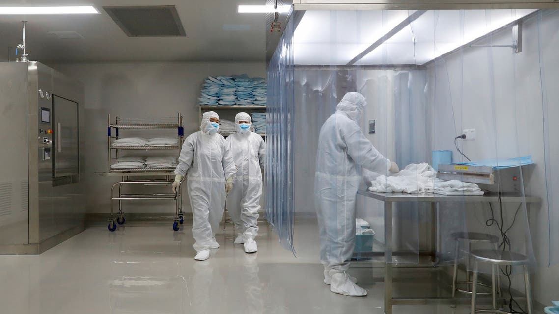 People work at a facility of Chinese vaccine maker Sinovac Biotech, that is developing an experimental coronavirus disease (COVID-19) vaccine, during a government-organized media tour in Beijing, China, September 24, 2020. Picture taken September 24, 2020. REUTERS/Thomas Peter