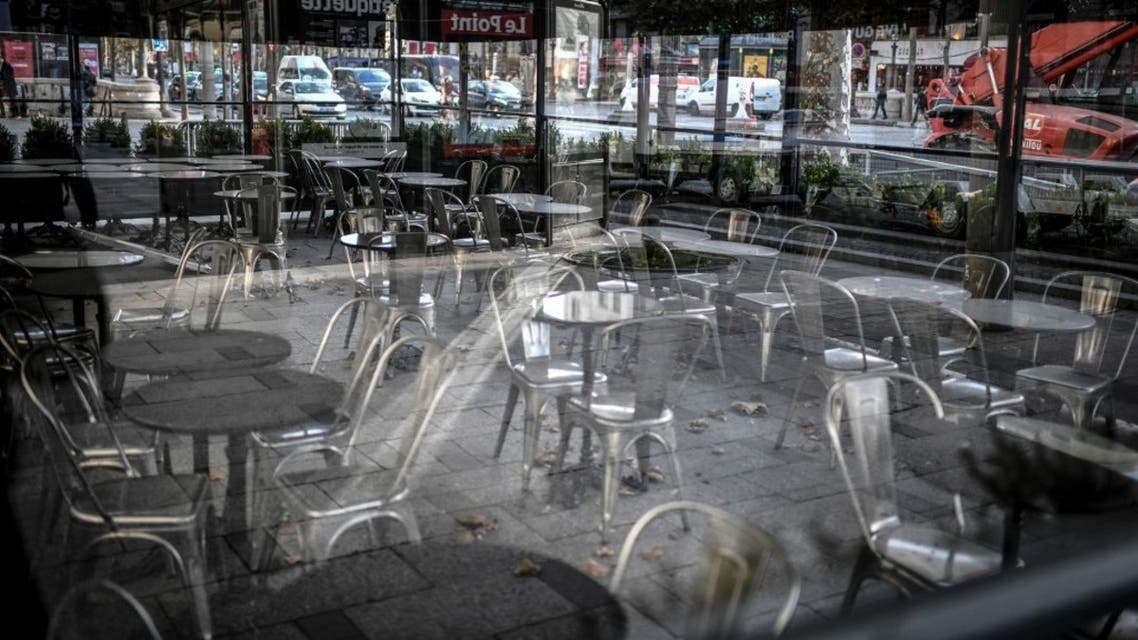 This photo taken on November 12, 2020, shows the empty terrace of a closed restaurant, seen through a window, on the Champs-Elysees avenue in Paris, during a second national lockdown in France. (AFP)