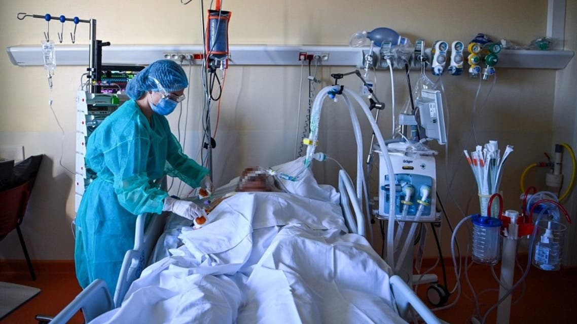 A member of the medical staff tends to a patient at an intensive care unit for patients infected with Covid-19 near Paris on November 4, 2020. (AFP)