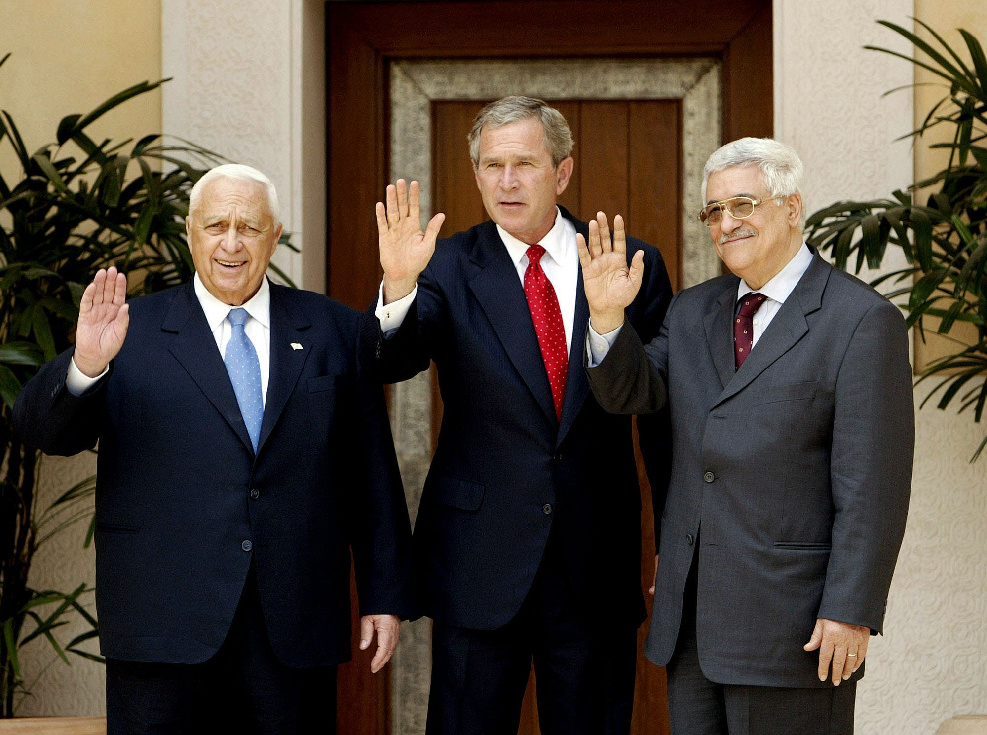 US President George W. Bush, center, with Israel's Prime Minister Ariel Sharon, left, and Palestinian Prime Minister Mahmoud Abbas, right at Beit al Bahar Palace on June 4, 2003. (AP)