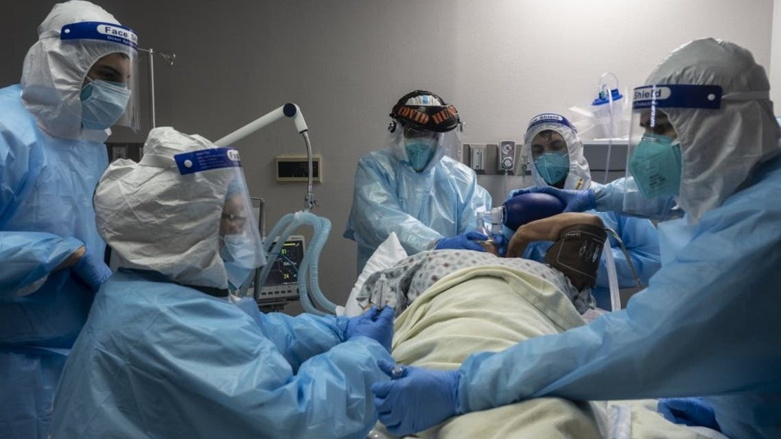 Medical staff members treat a patient suffering from coronavirus in the COVID-19 intensive care unit (ICU) on November 10, 2020 in Houston, Texas. (AFP)