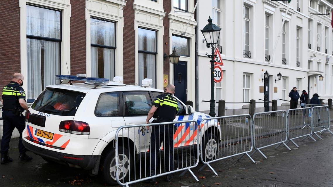 Police officers stand near the Embassy of Saudi Arabia after unidentified assailants sprayed it with gunfire, in The Hague, Netherlands November 12, 2020. (Reuters)