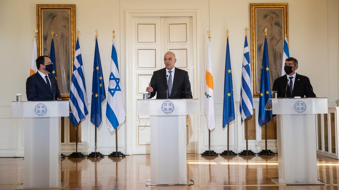 Greek Foreign Minister Nikos Dendias, centre, speaks during a join news conference next to his Israel's counterpart Gabi Ashkenazi, right, and Cypriot Foreign Minister Nikos Christodoulides, left, after their meeting in Athens, on Tuesday, Oct. 27, 2020. (AP)