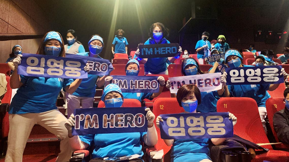 Fans of South Korean singer Lim Young-woong pose for photographs with banners bearing his name, before watching a movie featuring trot singers including Lim Young-woong, at a theater in Gunpo, South Korea, October 22, 2020. (Reuters)