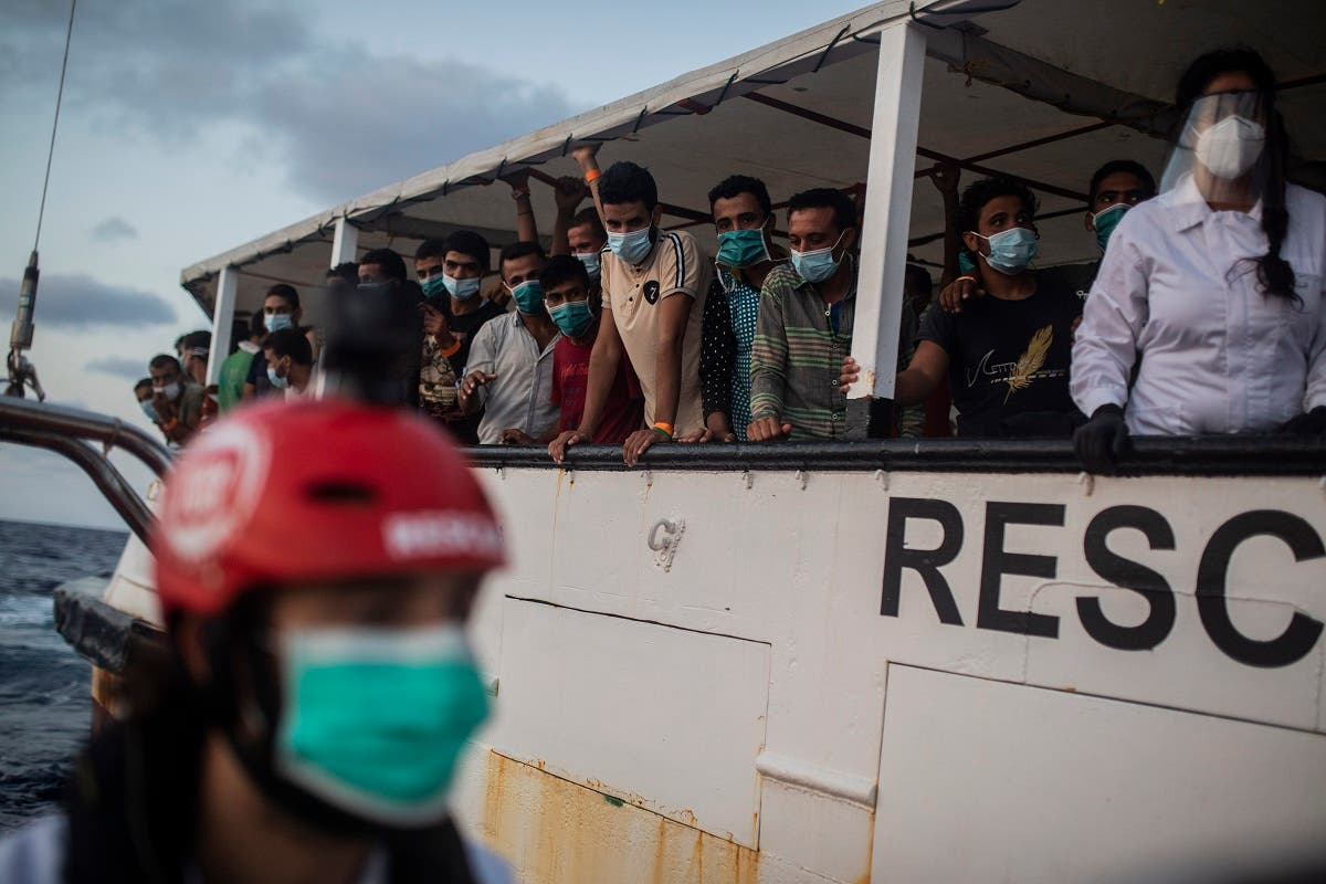 Migrants from different nationalities rest on board the Spanish NGO Open Arms vessel after being rescued as they were trying to flee Libya on board a precarious wooden boat, in international waters, in the Central Mediterranean sea. (AP)