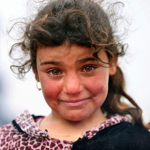 """صورتها هزت مشاعر الملايين.. هل تذكرون """"موناليزا"""" الموصل؟"""