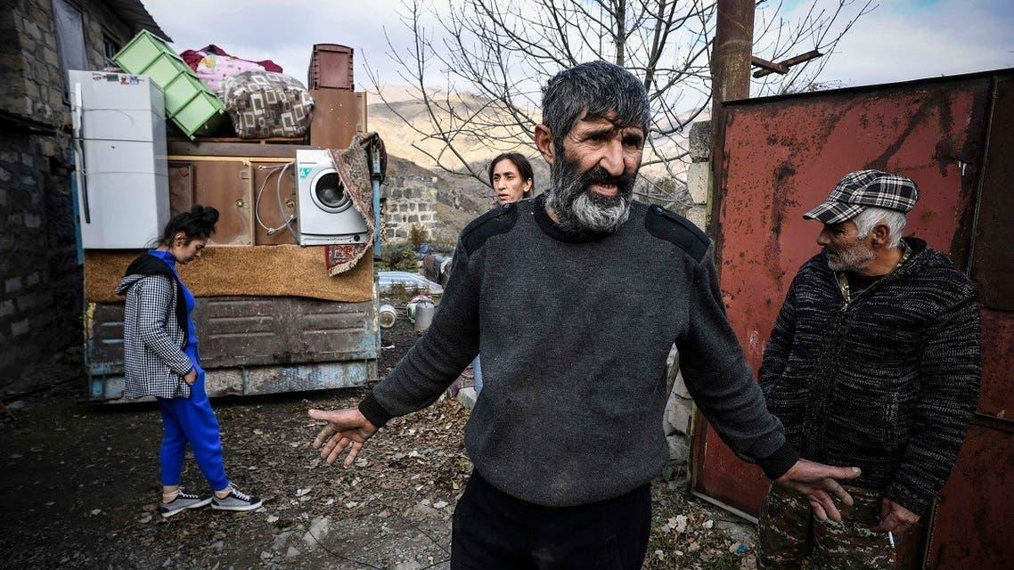 Armenians pack their belongings while leaving their house in the town of Kalbajar on November 12, 2020, during the military conflict between Armenia and Azerbaijan over the breakaway region of Nagorno-Karabakh. (Alexander Nemenov/AFP)