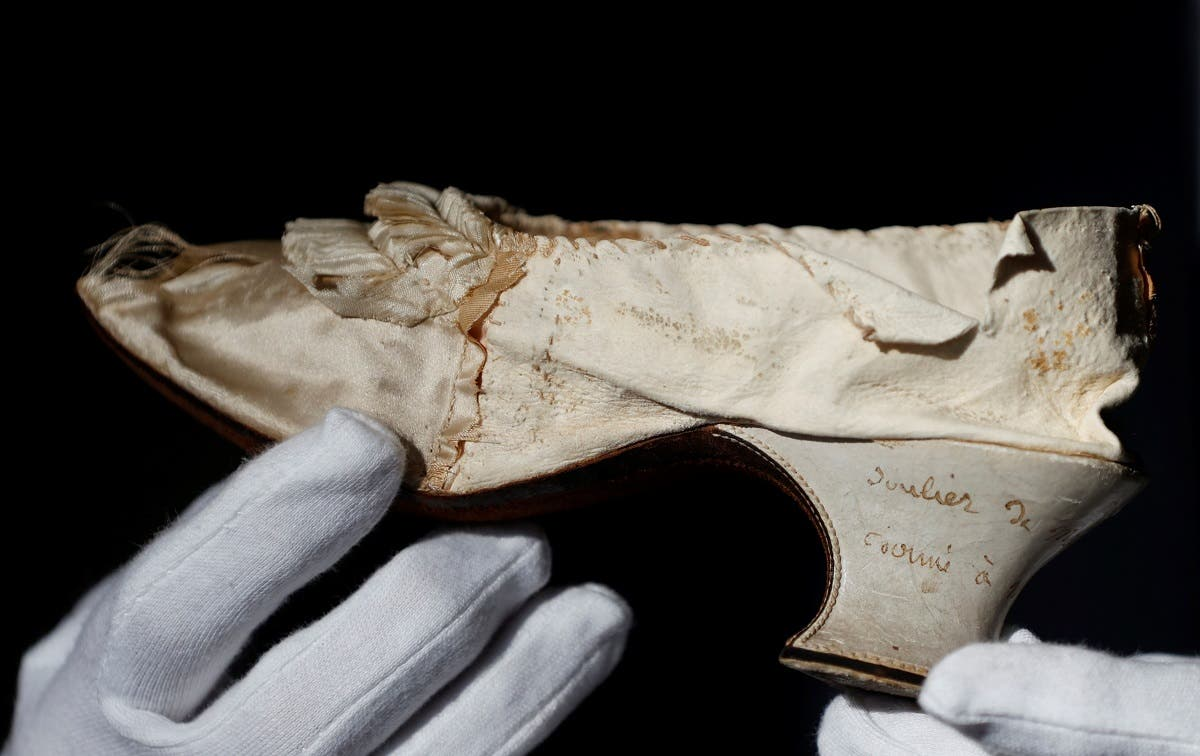 Osenat displays a shoe that belonged to late French queen Marie-Antoinette, in Versailles, near Paris, France, November 14, 2020. (Reuters/Christian Hartmann)