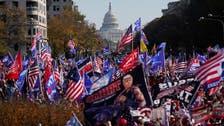Trump loyalists gather as US president drives through Washington