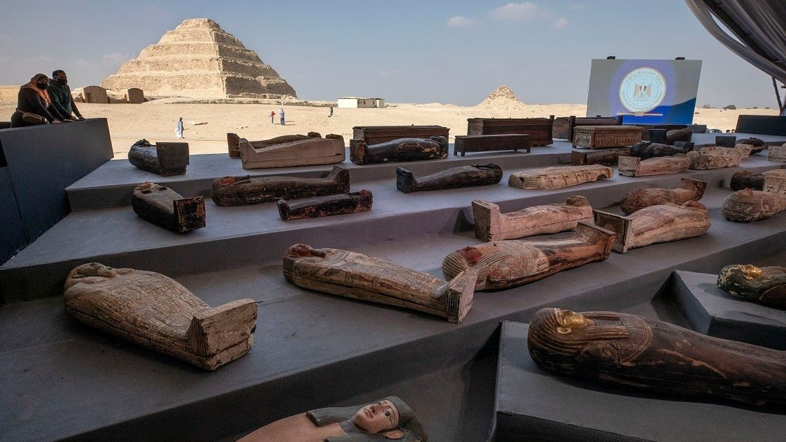 People look at ancient sarcophagus more than 2500 years old discovered in a vast necropolis in Saqqara, Giza, Egypt,  Nov. 14, 2020. (AP)