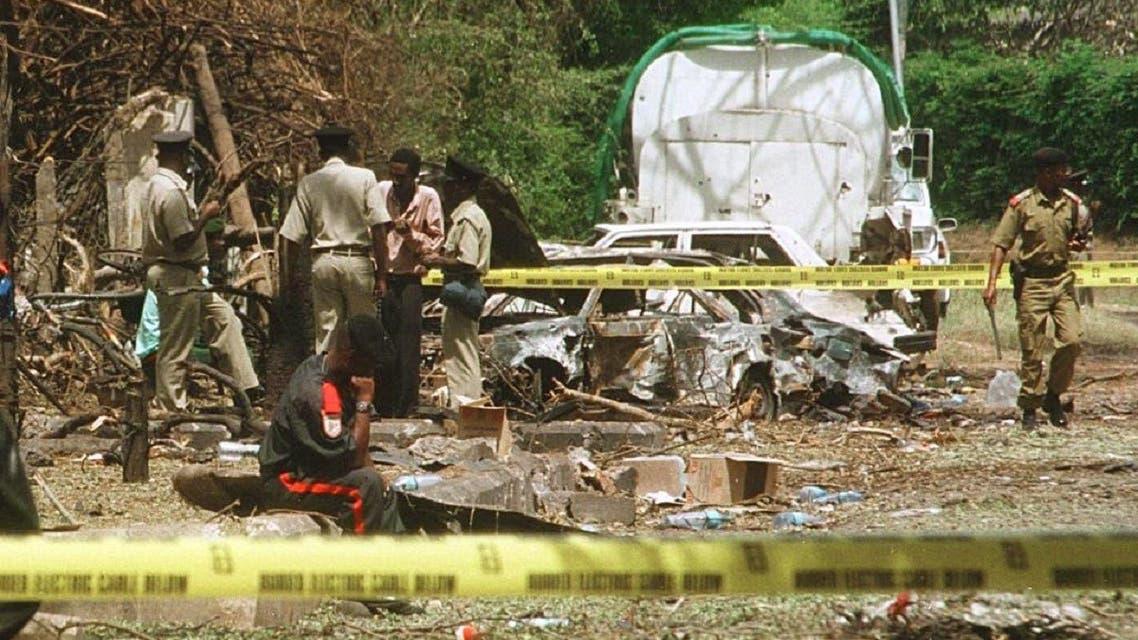 Policemen check debris US embassy building that was bombed Aug. 7, 1998 in Dar es Salaam, Tanzania. (AFP)