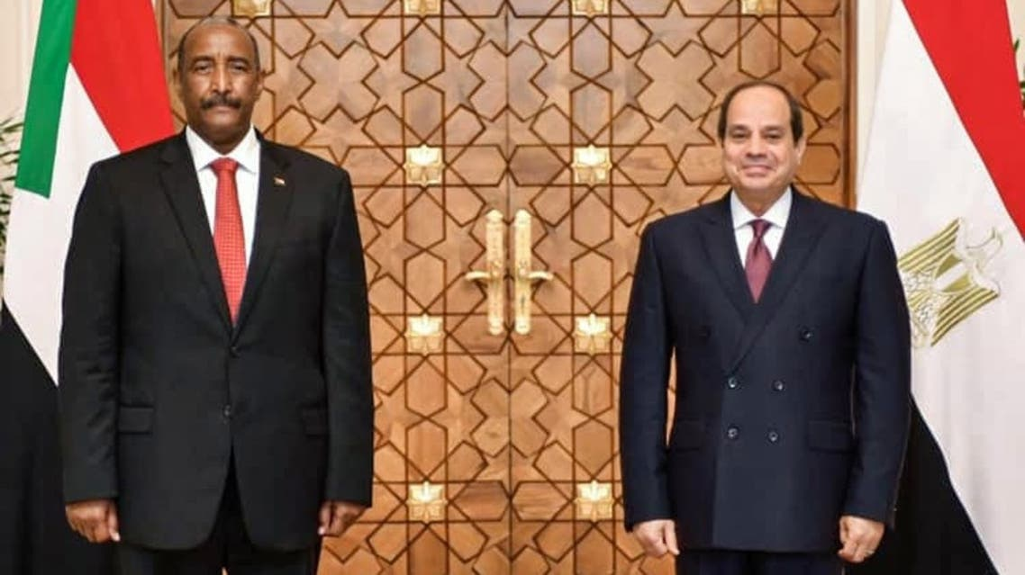 A picture released on October 27, 2020 shows Egyptian President al-Sisi (R) meeting with President of the Sudanese Sovereign Council General Abdel Fattah al-Burhan, at the presidential palace in the capital Cairo. (Egyptian Presidency/AFP)