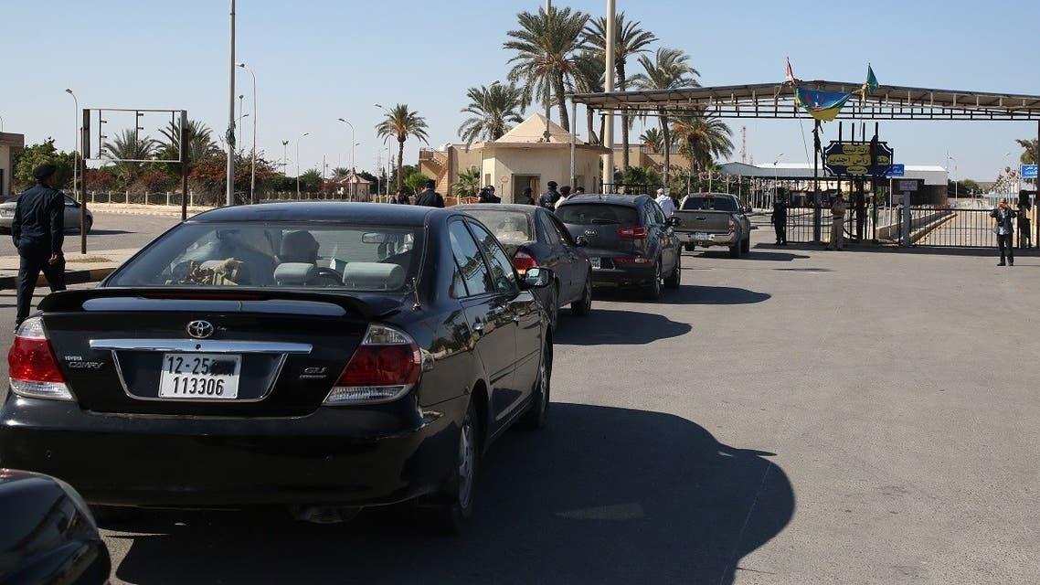 Cars in Libya cross to neighboring Tunisia via the Ras Jedir border post, after its reopening on November 14, 2020. (Mahmud Turkia/AFP)