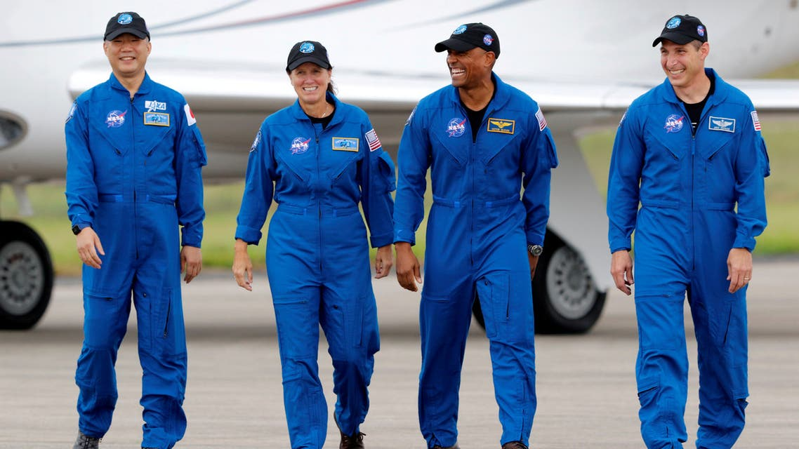 FILE PHOTO: NASA astronauts Shannon Walker, Victor Glover, Mike Hopkins, and JAXA (Japan Aerospace Exploration Agency) astronaut Soichi Noguchi, who comprise Crew-1, walk at Kennedy Space Center ahead of the NASA/SpaceX launch of the first operational commercial crew mission in Cape Canaveral, Florida, U.S., November 8, 2020. REUTERS/Joe Skipper/File Photo
