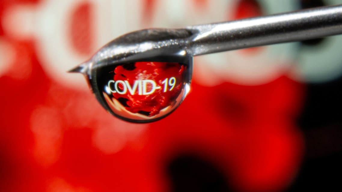 The word COVID-19 is reflected in a drop on a syringe needle in this illustration taken November 9, 2020. (Reuters)