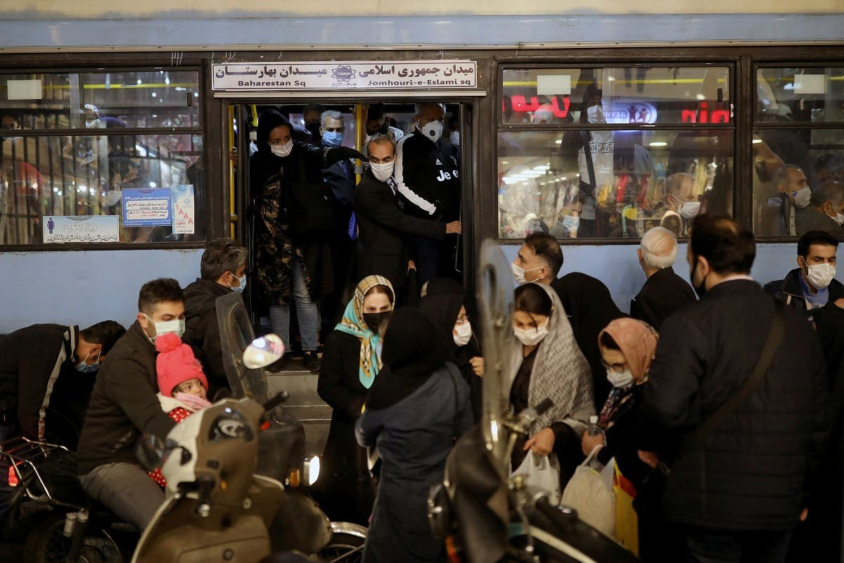 Iranians wearing protective masks are pictured at a bus, amid the outbreak of the coronavirus disease in Tehran, Iran November 11, 2020. (Reuters)