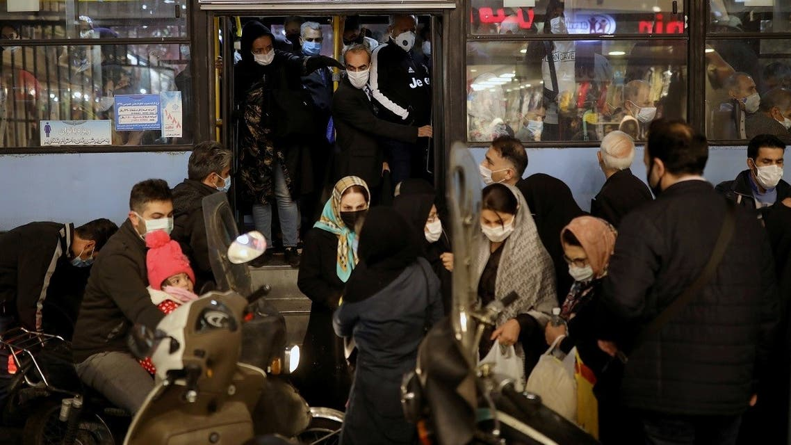 Iranians wearing protective masks are pictured at a bus, amid the outbreak of the coronavirus disease in Tehran, Iran November 11, 2020. (Majid Asgaripour/WANA (West Asia News Agency) via Reuters)