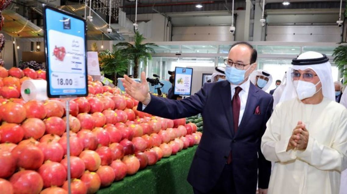 Shlomi Fogel, Chairman of Carmel Agrexco and Sultan Ahmed Bin Sulayem, Group Chairman and CEO of DP World, at the opening of the first-ever stall for the Israeli agriculture products in Dubai. (WAM)