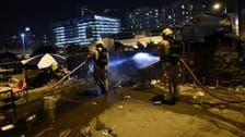Seven dead in Hong Kong apartment fire, say officials