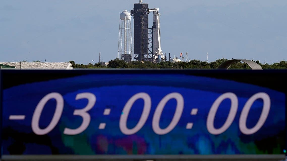 The countdown clock is stopped at a three-hour built in hold as a SpaceX Falcon 9 rocket,sits on the launch pad at Launch Complex 39A, Nov. 15, 2020, at the Kennedy Space Center in Cape Canaveral, Fla. (AP/Chris O'Meara)
