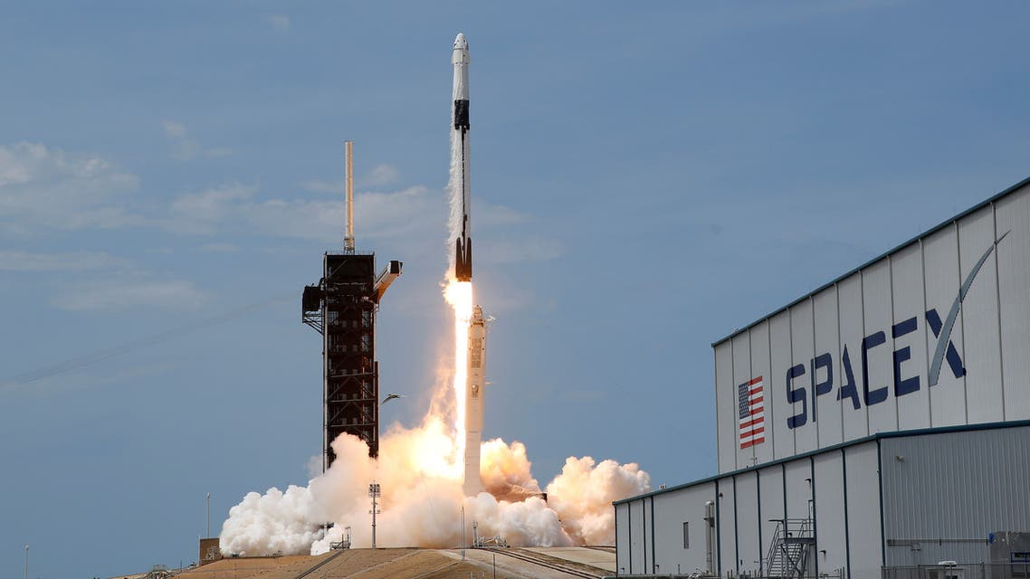 FILE PHOTO: FILE PHOTO: A SpaceX Falcon 9 rocket and Crew Dragon spacecraft carrying NASA astronauts Douglas Hurley and Robert Behnken lifts off during NASA's SpaceX Demo-2 mission to the International Space Station from NASA's Kennedy Space Center in Cape Canaveral, Florida, U.S., May 30, 2020. REUTERS/Joe Skipper/File Photo/File Photo