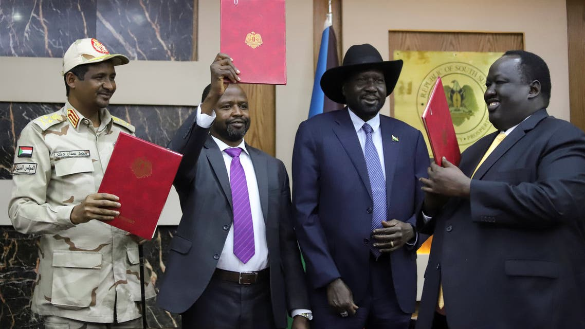 General Mohamed Hamdan Dagalo, Deputy Head of the Sudan Transitional Military Council (L), Alhadi Idris, Chairman of the Sudanese Revolutionary Front (C), South Sudan President Salva Kiir and Tut Galwak, Chairman of the South Sudanese Mediation Committee hold the agreement on peace and ceasefire during the signing ceremony in Juba, South Sudan October 21, 2019. REUTERS/Jok Solomun
