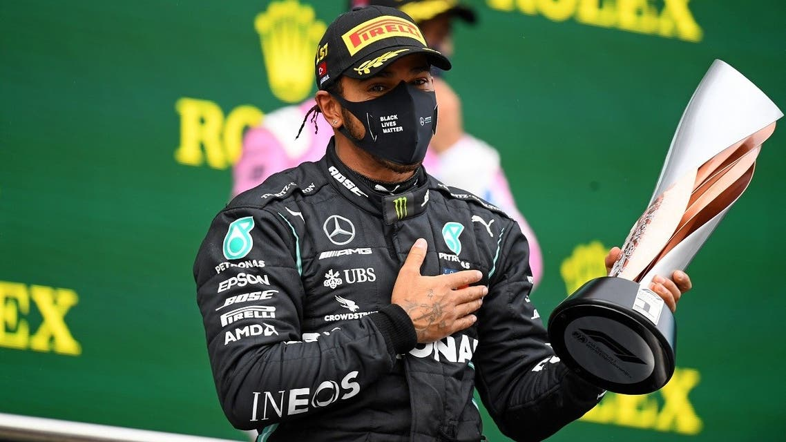 Mercedes' British driver Lewis Hamilton celebrates on the podium after winning the Turkish Formula One Grand Prix at the Intercity Istanbul Park circuit in Istanbul on November 15, 2020. (Clive Mason/Pool/AFP)