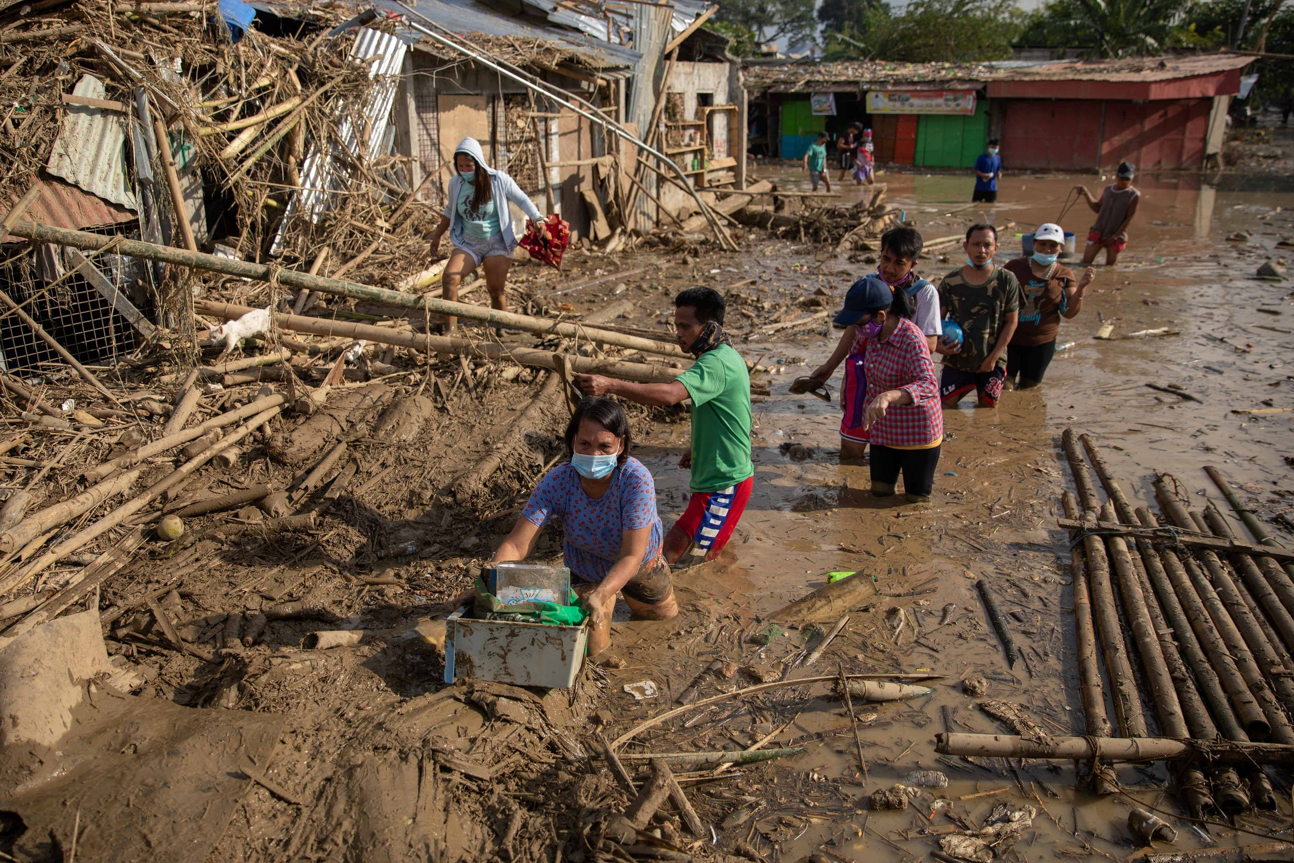 Residents retrieve belongings from their submerged village following floods caused by Typhoon Vamco, in Rodriguez, Rizal province, Philippines. (Reuters)