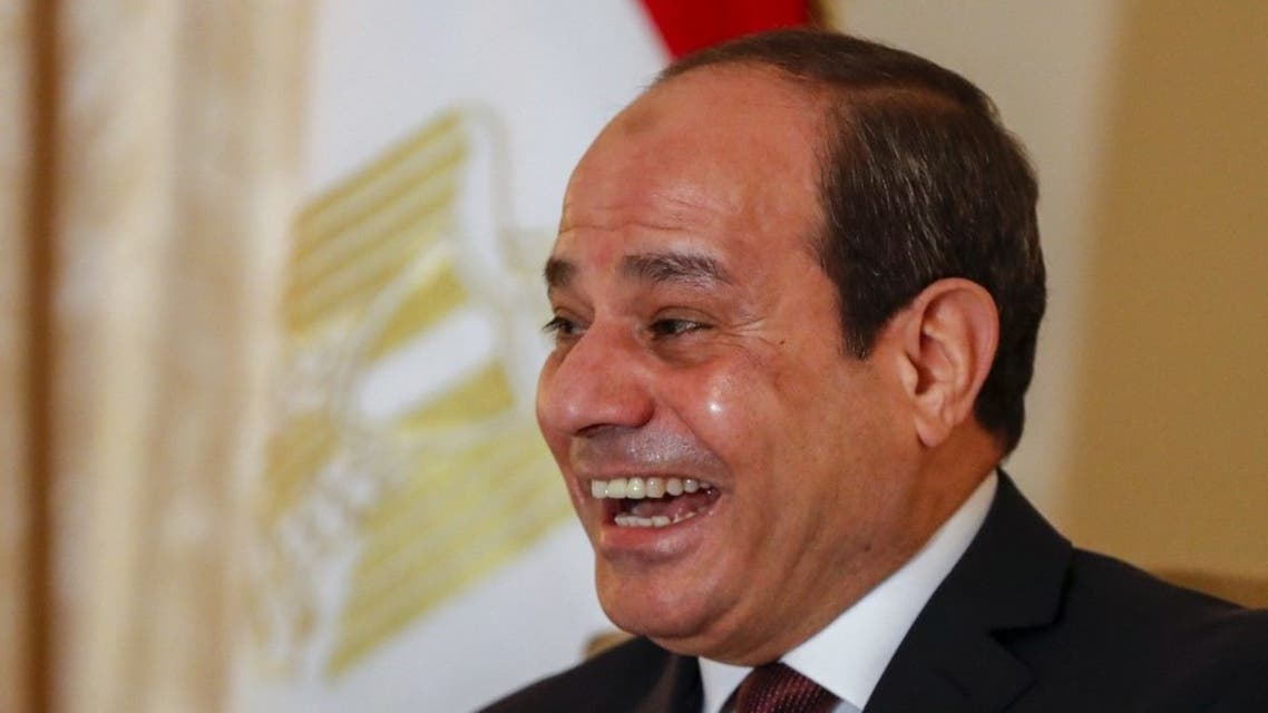 Egyptian President Abdul Fattah al-Sisi smiles prior a meeting for bi-lateral talks with US Secretary of State prior a Peace summit on Libya in Berlin on January 19, 2020. (AFP)