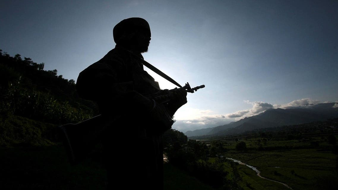A file photo shows an Indian army soldier stands guard while patrolling near the Line of Control, a ceasefire line dividing Kashmir between India and Pakistan, in Poonch district