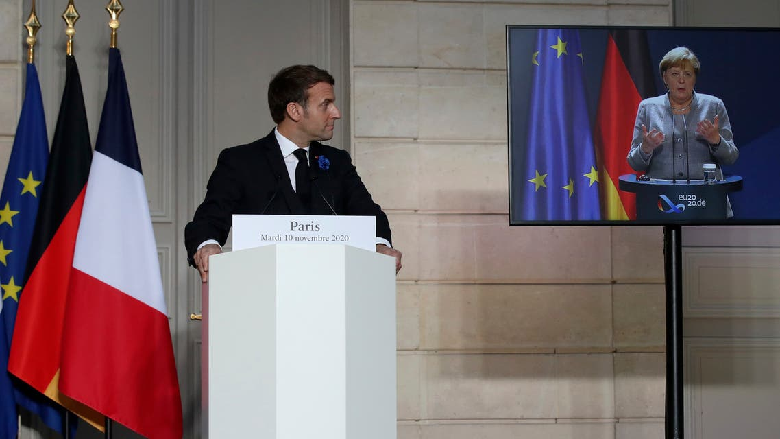 German Chancellor Angela Merkel listens to French president Emmanuel Macron, Nov. 10, 2020. (AP)