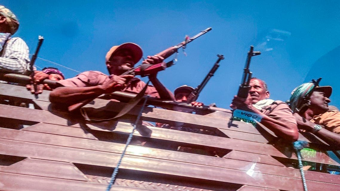 A picture taken through a car window shows Ethiopian Amhara militia fighters, that combat alongside federal and regional forces against northern region of Tigray, Gondar, Ethiopia, November 09, 2020. (Eduardo Soteras/AFP)