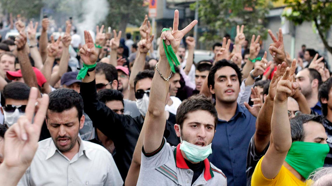 EDITORS' NOTE: Reuters and other foreign media are subject to Iranian restrictions on their ability to film or take pictures in Tehran. Supporters of opposition leader Mirhossein Mousavi march in north Tehran July 30, 2009. Baton-wielding Iranian police fired tear gas on Thursday and arrested protesters mourning the young woman killed in post-election violence who has become a symbol for the opposition to Tehran's hardline leaders. Picture taken July 30, 2009. REUTERS/Stringer (IRAN POLITICS CONFLICT)