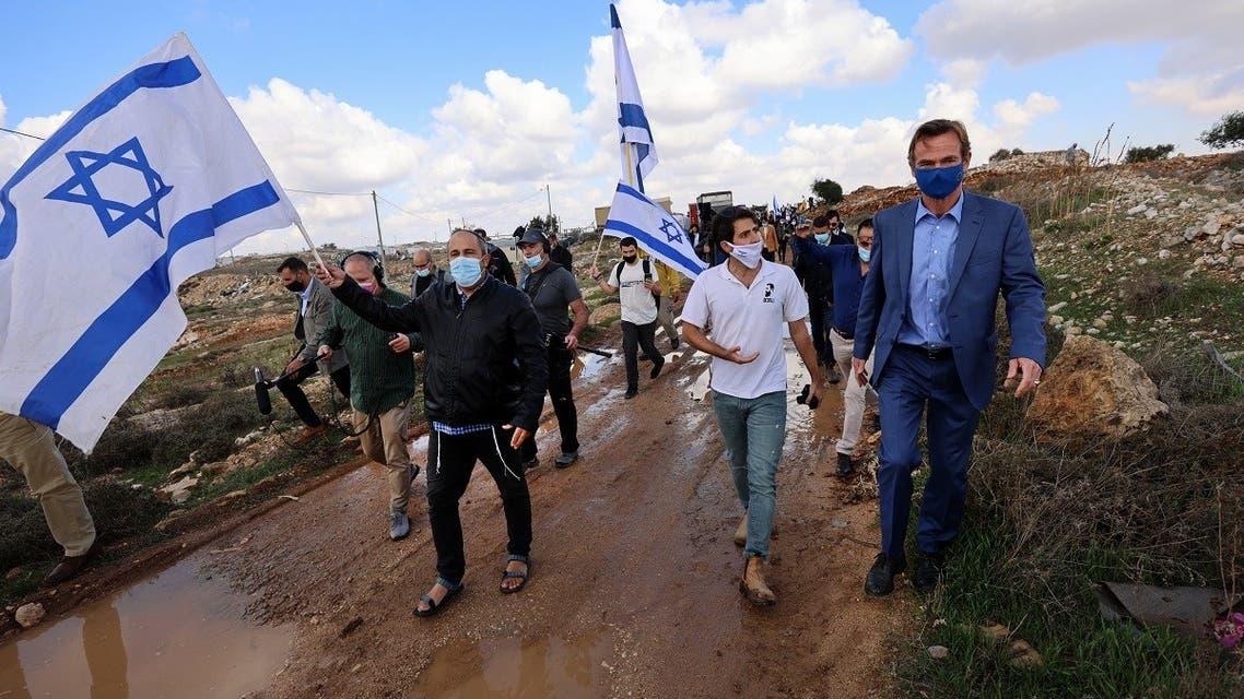Israeli protestors heckle EU representative in the Palestinian territories Sven Kuhn von Burgsdorff (R) as he leads an EU delegation on the site of planned extension of the Givat Hamatos settlement in east Jerusalem, November 16, 2020. (Emmanuel Dunand/AFP)