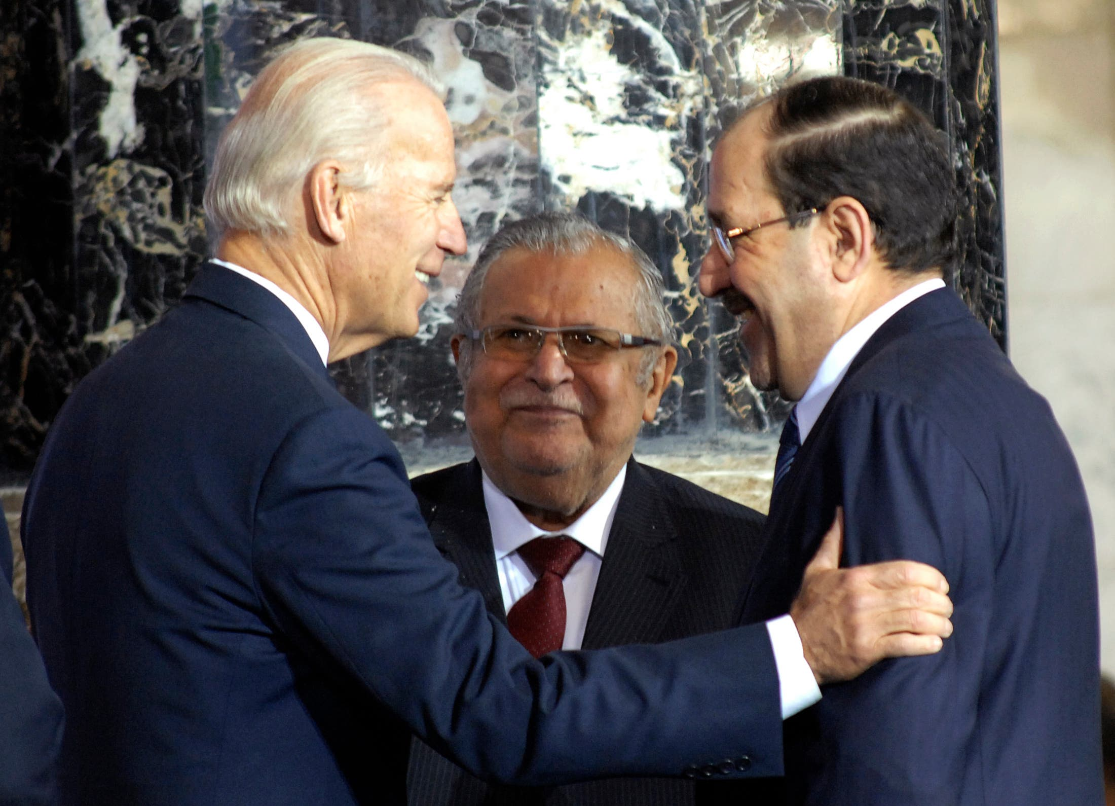 US Vice President Joe Biden (L) talks to Iraq's Prime Minister Nuri al-Maliki (R) and Iraq's President Jalal Talabani during one of several planned ceremonies to mark the end of American military presence in Iraq, in Baghdad December 1, 2011. (Reuters)