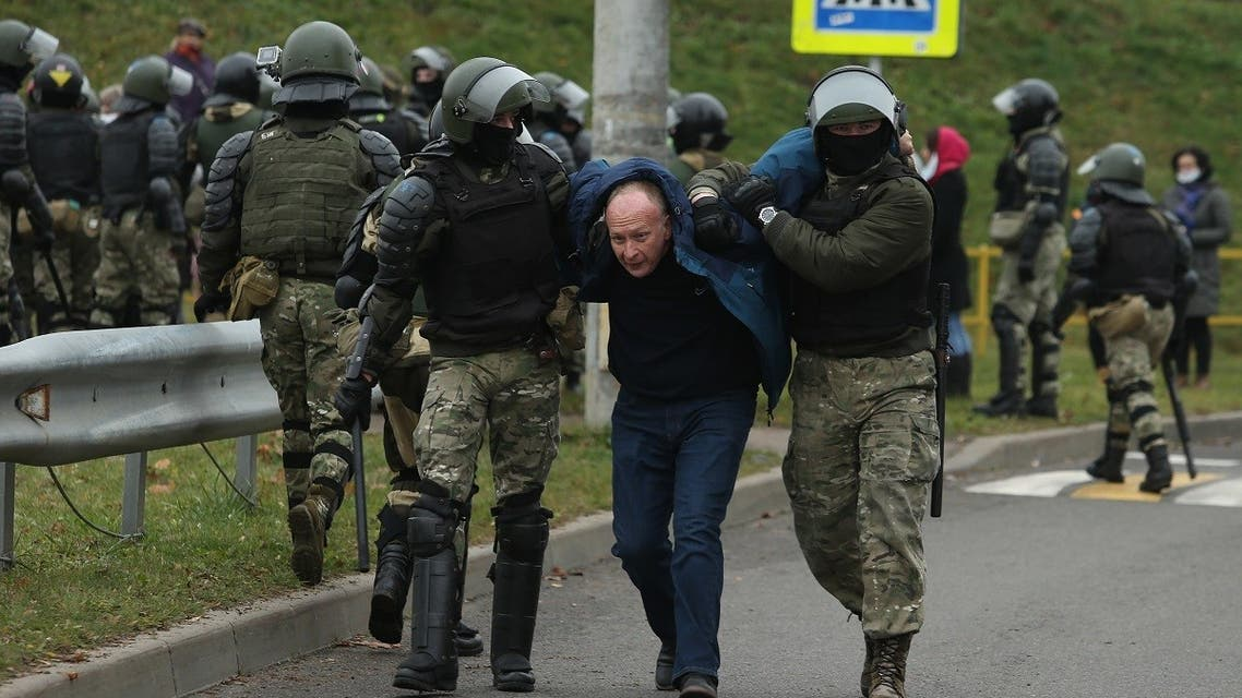 Law enforcement officers detain an opposition supporter during a rally to protest against the Belarus presidential election results in Minsk, on November 15, 2020. (Stringer/AFP)
