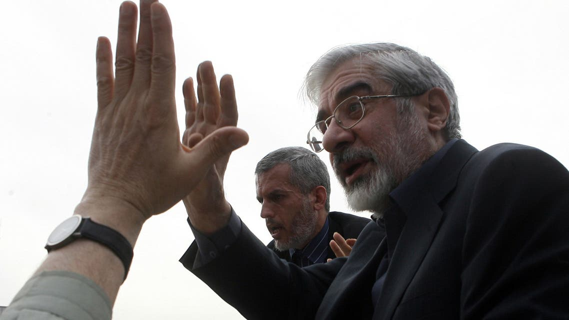 A picture obatained from the election campaign website of Iran's defeated presidential candidate Mir Hossein Mousavi, GHALAMNEWS.IR, shows the opposition leader addressing his supporters during a massive rally in Tehran's Imam Khomeini square on June 18, 2009. Tens of thousands of Mousavi supporters demonstrated for a sixth straight day, keeping up the pressure on the Islamic regime over the disputed vote. Mousavi appeared despite warnings from the hardline Basij militia, which has been at the forefront of action against protests, for defeated candidates to dissociate themselves from the rioters. AFP PHOTO/GHALAMNEWS.IR -- RESTRICTED TO EDITORIAL USE --