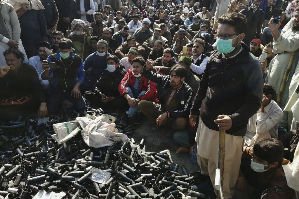 Activists and supporters of Tehreek-e-Labbaik Pakistan (TLP), a religious party, gather beside empty tear gas shells fired by police during an anti-France demonstration in Islamabad on November 16, 2020. (AFP)