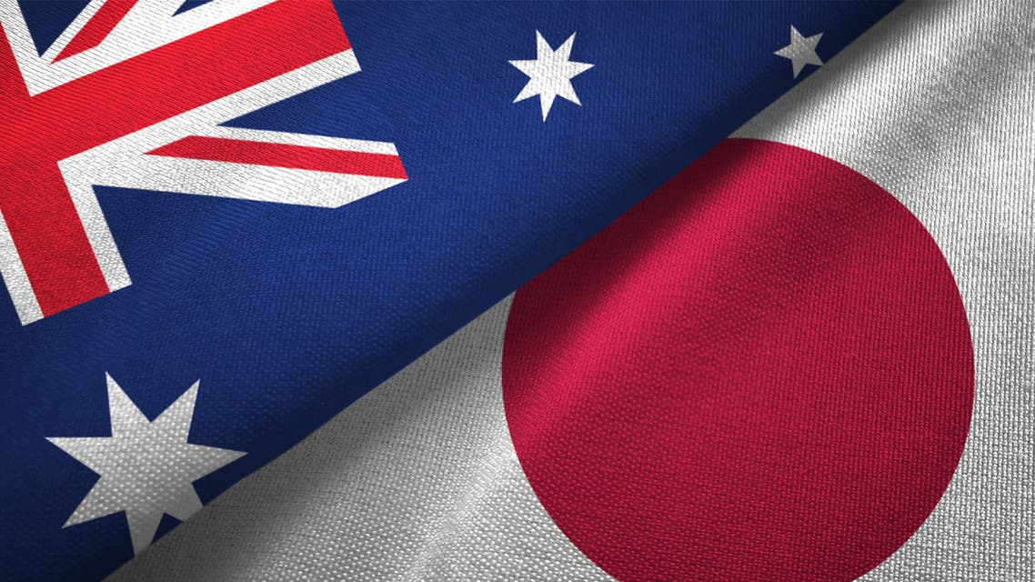 Japan and Australia two flags together realations textile cloth fabric texture stock photo