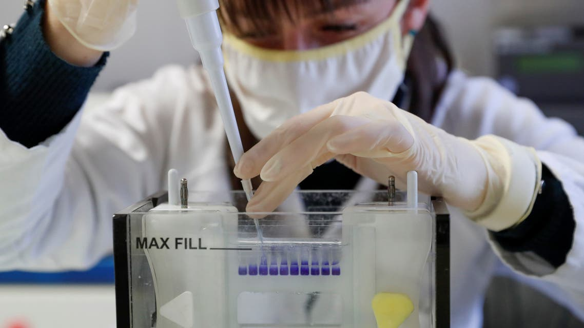 Hungarian biologist Alexandra Torok checks the purity of an antibody, a genetic sensor of sorts, manufactured by a small family company and sold to the largest pharmaceutical companies in the race for a coronavirus vaccine, in Szirak, Hungary, November 13, 2020. (Reuters)
