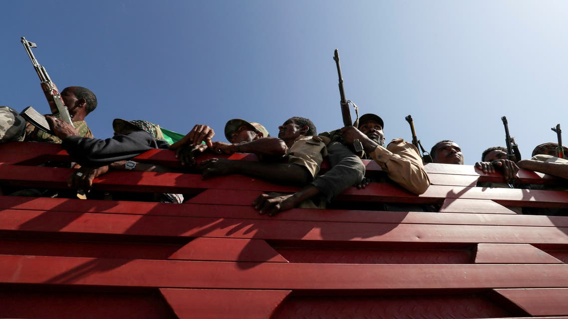 Militia members from Ethiopia's Amhara region ride on their truck as they head to face the Tigray People's Liberation Front (TPLF), in Sanja, Amhara region near a border with Tigray, Ethiopia, November 9, 2020. (Reuters)