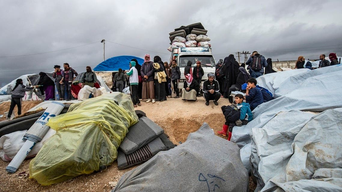 Syrians load their belonging onto trucks as they prepare to leave the Kurdish-run al-Hol camp in the al-Hasakeh governorate in northeastern Syria, on November 16, 2020. (Delil Souleiman/AFP)
