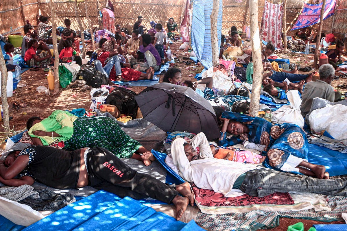 Ethiopian refugees who fled fighting in Tigray province lay in a hut at the Um Rakuba camp in Sudan's eastern Gedaref province, on November 16, 2020. (Ebrahim Hamid/AFP)