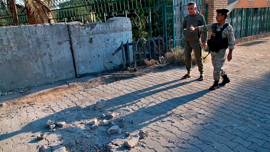 Security forces inspect the scene of the rocket attack at the gate of al-Zawra public park in Baghdad, Iraq, on November 18, 2020. (AP)