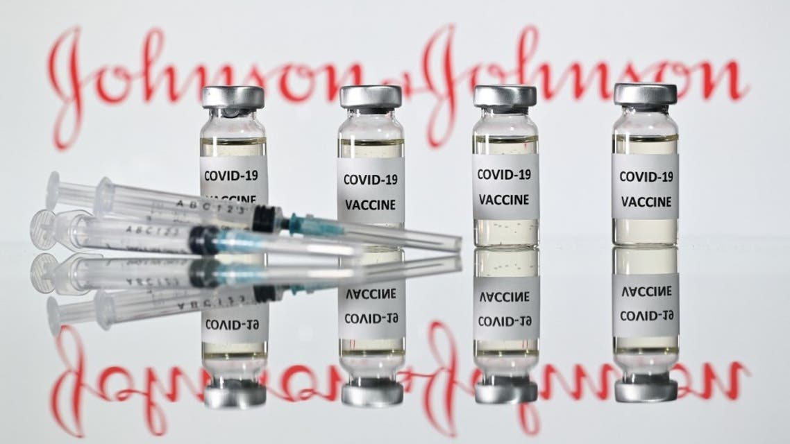 An illustration picture shows vials with Covid-19 Vaccine stickers attached and syringes with the logo of US pharmaceutical company Johnson & Johnson on November 17, 2020. (AFP)