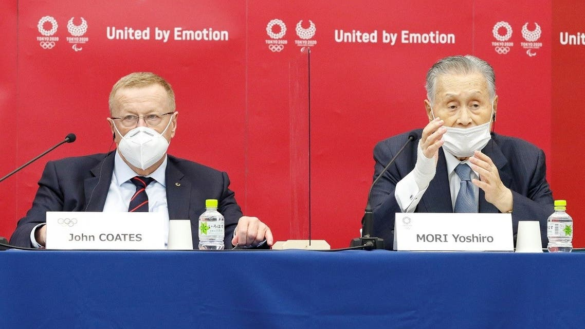 John Coates, Chairman of the Coordination Commission for the Games of the XXXII Olympiad Tokyo 2020, and President of Tokyo 2020 Yoshiro Mori attend a joint press conference at Harumi Island Triton Square Tower Y in Tokyo, Japan November 18, 2020. (Rodrigo Reyes Marin/Pool via Reuters)